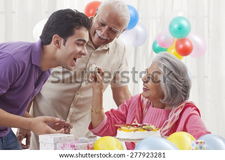 Family celebrating birthday - stock photo