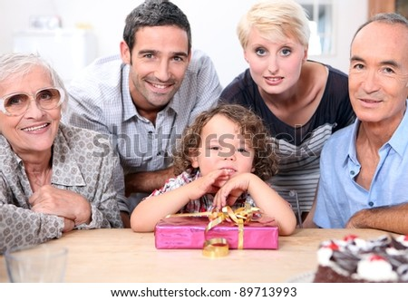 Family celebrating little boy birthday - stock photo