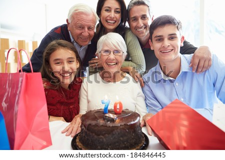 Family Celebrating 70th Birthday Together - stock photo