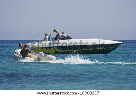 family changing boats - saint-tropez, french riviera - stock photo