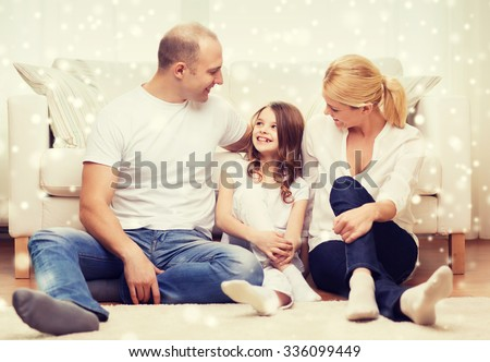family, childhood, communication, people and home concept - smiling parents with little girl sitting on floor at home - stock photo
