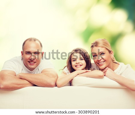 family, childhood, ecology and people - smiling mother, father and little girl over green background - stock photo