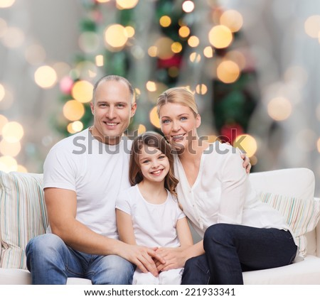 family, childhood, holidays and people concept - smiling mother, father and little girl over christmas tree lights background - stock photo