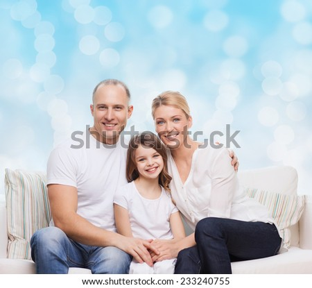 family, childhood, holidays and people concept - smiling mother, father and little girl over blue lights background