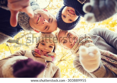 family, childhood, season, gesture and people concept - happy family pointing finger on you in autumn park - stock photo