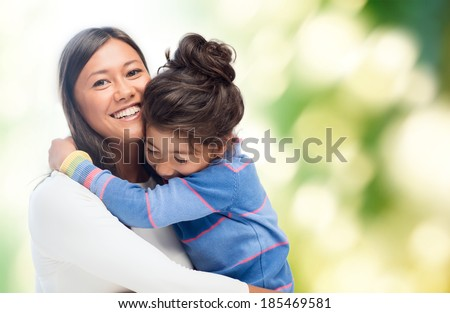 family, children and happy people concept - hugging mother and daughter - stock photo