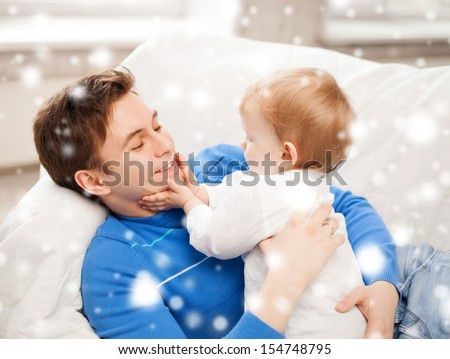 family, children, christmas, x-mas, love concept - happy father with adorable baby - stock photo