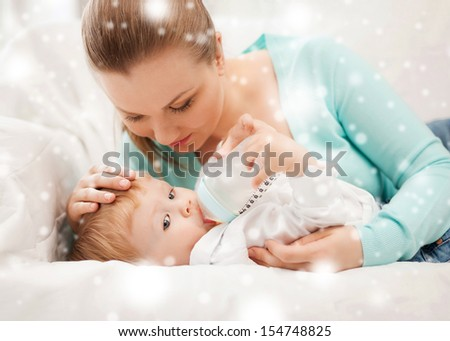family, children, christmas, x-mas, love concept - happy mother and adorable baby with feeding-bottle - stock photo