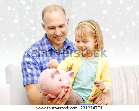 family, children, money, investments and happy people concept - happy father and daughter with big pink piggy bank - stock photo