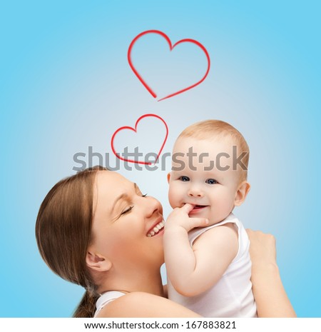 family, children, parenthood and happiness concept - happy mother with adorable baby - stock photo