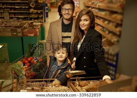 Family choosing bread in a grocery store - stock photo