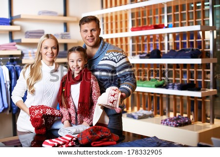 Family choosing winter clothes  - stock photo