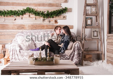family, christmas, holidays, love and people concept - couple in love admiring each other