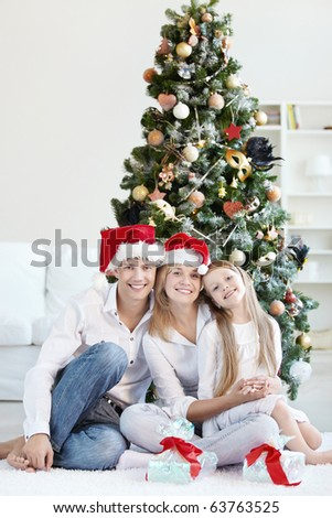 Family Christmas in caps at home - stock photo