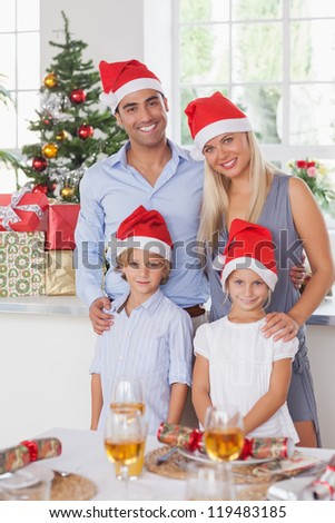 Family christmas portrait at the dinner table - stock photo