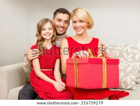 family, christmas, x-mas, happiness and people concept - happy family opening - stock photo