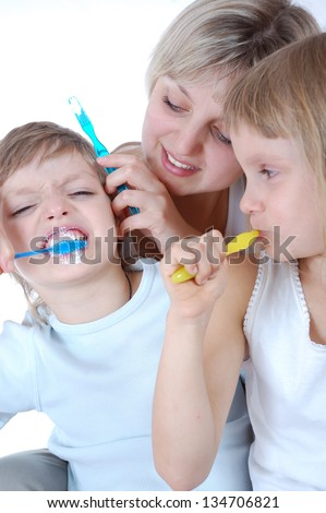 family cleaning teeth over white background
