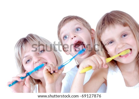 family cleaning  teeth over white background - stock photo