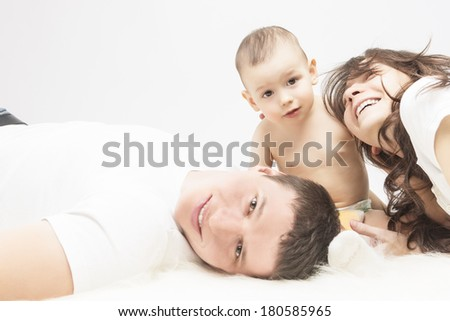 Family Concept: Family of Three People Together Smiling and Having a Good Time. Horizontal Image - stock photo