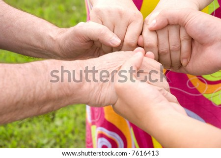 family concept (focus point on hands of the woman) - stock photo