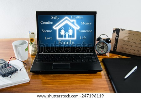 Family concept on computer on desktop - stock photo