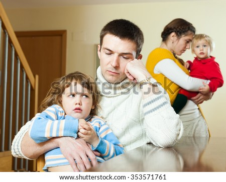 Family conflict. Young wife having conflict with husband at home - stock photo