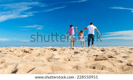 Family Day Out on the Beach - stock photo