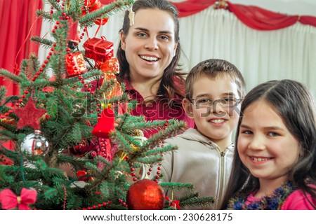 Family decorating Christmas tree At Home - stock photo