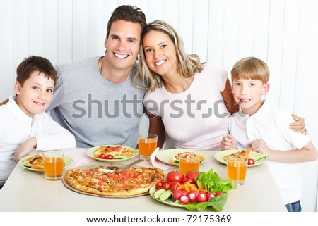 Family dinner. Father, mother and children eating a big pizza - stock photo