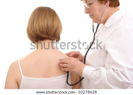 Family doctor examining female patient using stethoscope