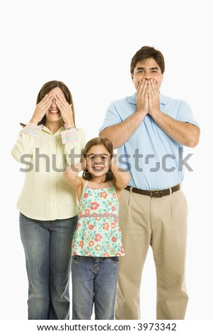 Family doing hear no evil, see no evil, speak no evil gestures. - stock photo