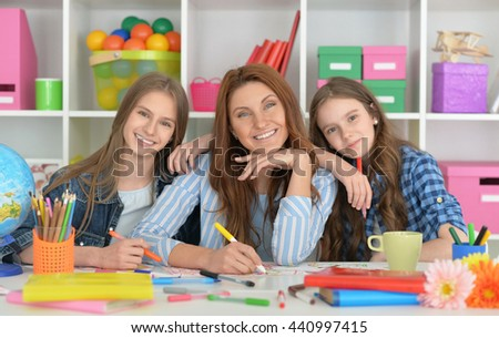family doing homework together - stock photo