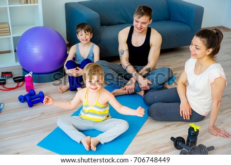 Family doing yoga together