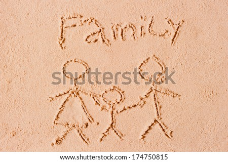 family drawing on the wet sand at the beach - stock photo