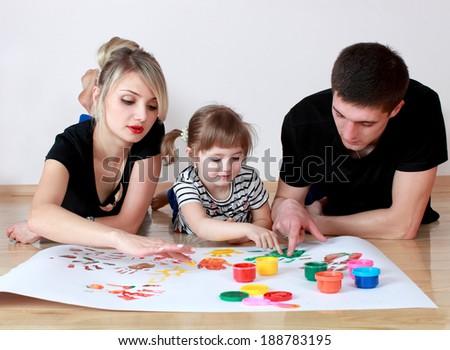 family draws paint on white - stock photo