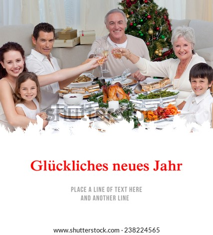 Family drinking a toast in a Christmas dinner against christmas greeting in german - stock photo