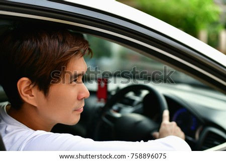 family Driving, male driving, safe driving concept, driver's view, family are driving safely on a safe route.