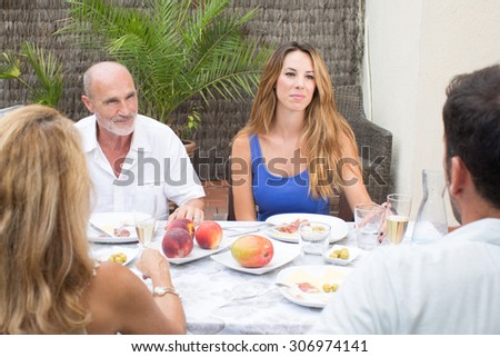Family during a conversation while having food in garden