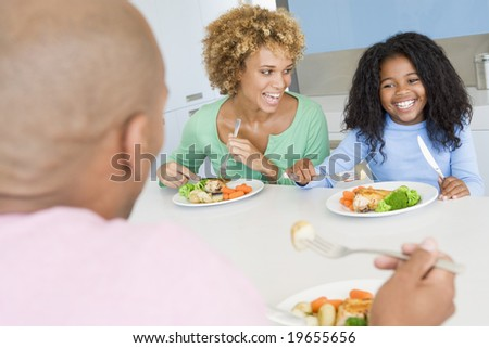 Family Eating A meal,mealtime Together