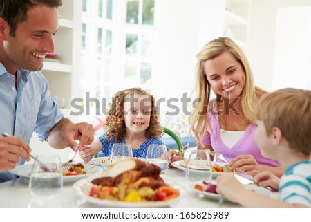 Family Eating Meal At Home Together - stock photo