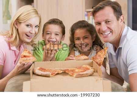 Family Eating Pizza Together - stock photo