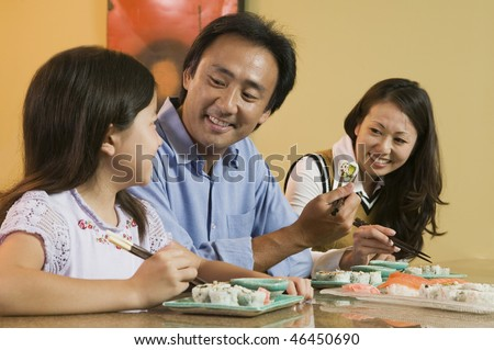 Family Eating Sushi Together - stock photo