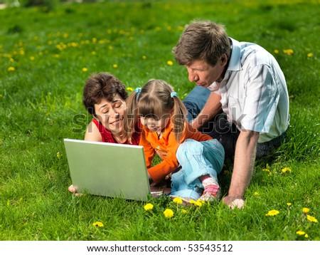 Family enjoy outdoors - stock photo