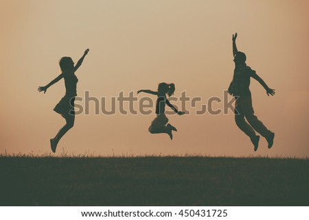 Family enjoy spending time together outdoor.Precious family moments Image is intentionally with grain and toned. - stock photo