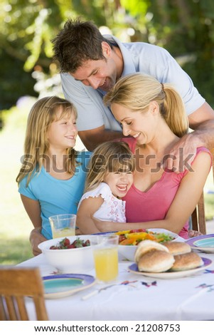 Family Enjoying A Barbeque - stock photo