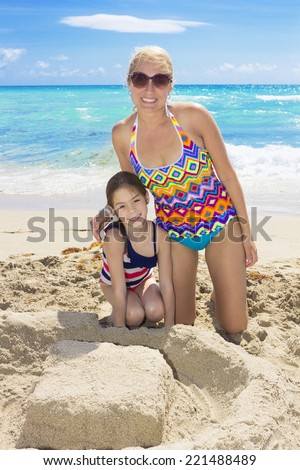 Family enjoying a beach vacation together - stock photo