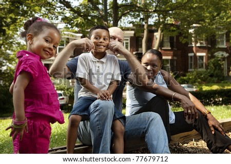 Family enjoying a day at the park - stock photo