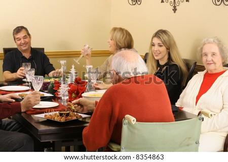 family enjoying a meal together - stock photo