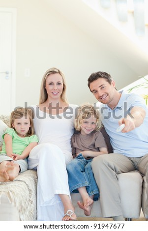 Family enjoying a movie together - stock photo