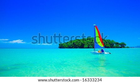 Family enjoying a ride in the sailboat at beautiful tropical sea - stock photo